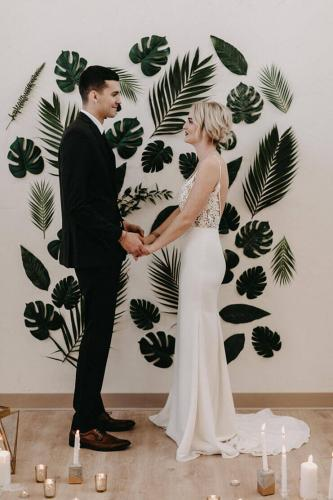 tropical leaf wall ceremony backdrop